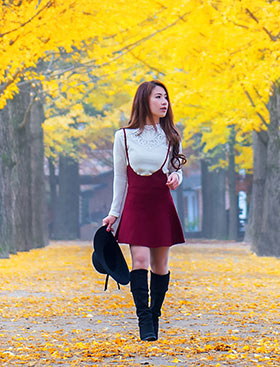 Korean girl on campus in the fall
